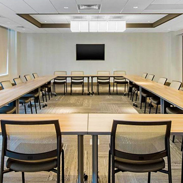 What is the size of the meeting spaces available at Cambria Hotel College Park?