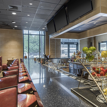 What food and drink options are available at Cambria Hotel College Park?